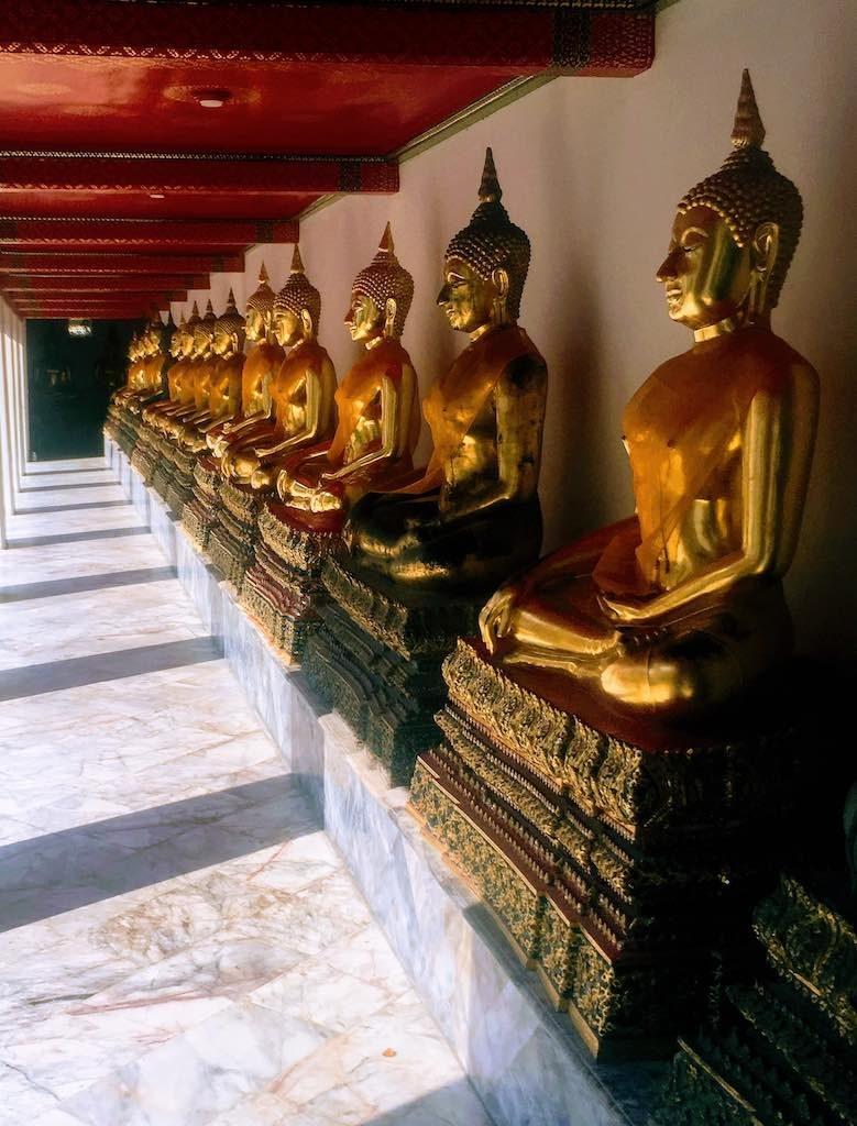 Buddha statues I budda figures at Wat Pho in Bangkok on WorldTravelConnector.com