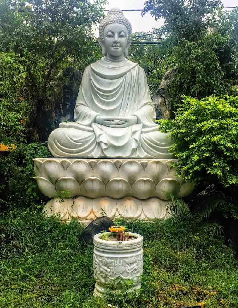 Gautama Buddha statue in Hoi An in Vietnam at WorldTravelconnector.com I Skinny Buddha vs Fat Buddha I buddha figure I
