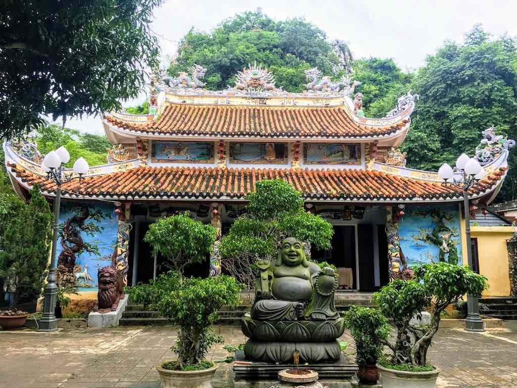 Skinny Buddha vs Fat Buddha_Fat Buddha statue at Tam Tai Pagoda in Da Nang I Photo Taken by WorldTraelConnector.com I I buddha laughing I hotei buddha I  laughing buddha I statue of laughing buddha I  laughing buddha statue I happy buddha statue I budai I Chinese Jolly  Buddha
