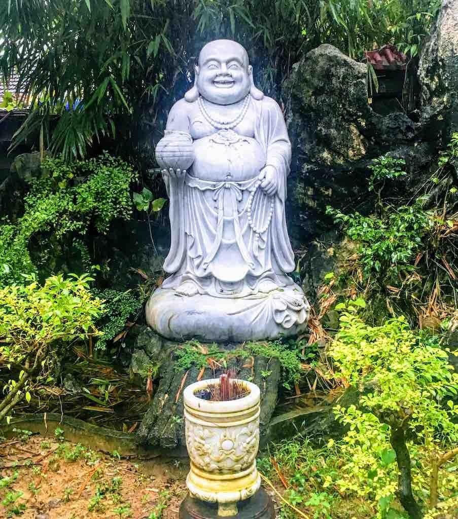 Skinny Buddha vs Fat Buddha in Hoi An in Vietnam