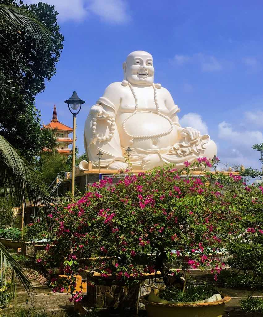 Skinny Buddha vs Fat Buddha in Vietnam I Laughing Buddha statue at Vinh Trang Temple in Vietnam by WorldTravelConnector.com  I buddha laughing I hotei buddha I  laughing buddha I statue of laughing buddha I  laughing buddha statue I happy buddha statue I budai I Chinese Jolly  Buddha