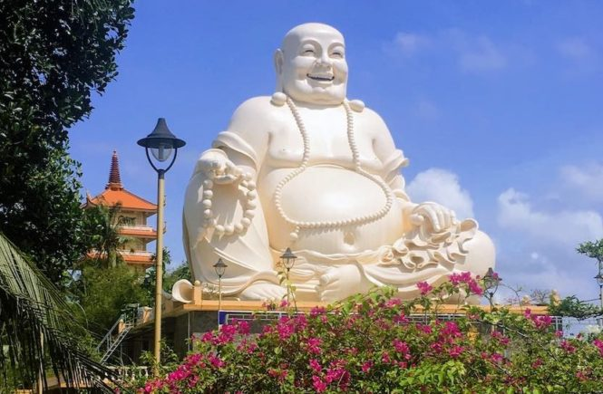 Skinny Buddha vs Fat Buddha in vinh Trang Temple in Vietnam