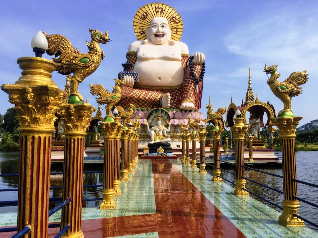 Fat Buddha statue at Wat Plai Laem  on Koh Samui I Photo taken by WorldTravelConnector.com I Skinny Buddha vs Fat Buddha I buddha laughing I hotei buddha I  laughing buddha I statue of laughing buddha I  laughing buddha statue I happy buddha statue I budai I Chinese Jolly  Buddha