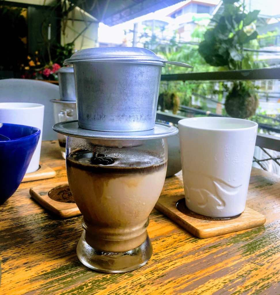 Vietnamese drip coffee should be on any list of most popular Vietnamese food and Vietnamese drinks