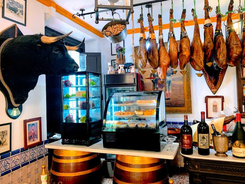Visiting a tapas bar in Seville on a southern Spain road trip is a must