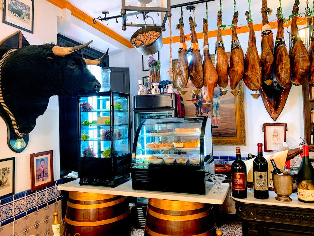 Visiting Seville tapas bars should be on any Andalucia road trip itinerary