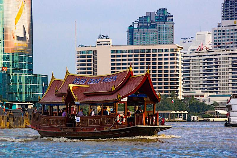 Taking a boat ride on Chao Praya River is one of top things to do in Bangkok