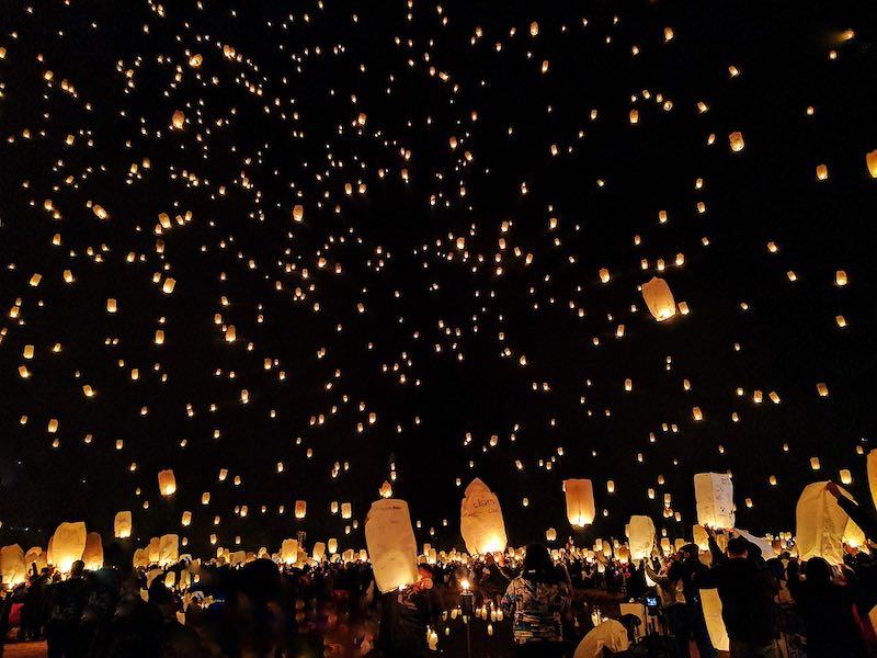 Releasing a sky lantern during Thai Lantern festival is one of the top Thailand things to do