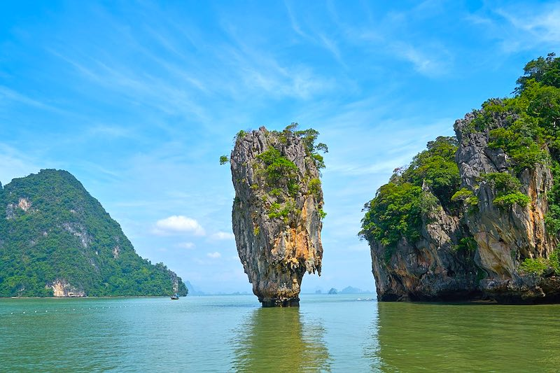 Visiting James Bond island in Phang Nga Bay in Thailand is one of the top Thailand things to do