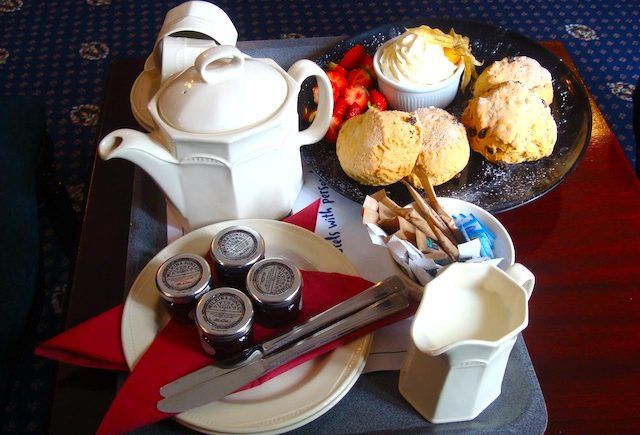 English scones, tea, strawberries and whipped cream