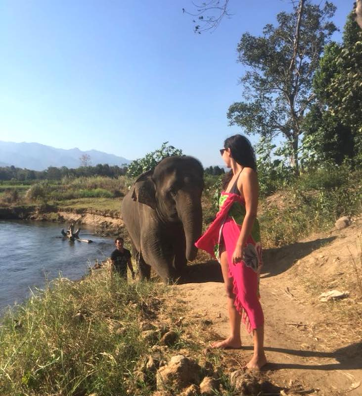 Milijana Gabric from WorldTravelConnector.com with an elephant in Thialand