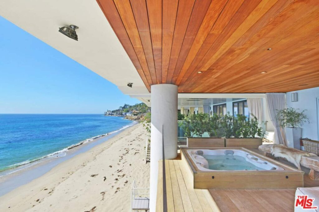 This beach house with oceanfront hot tube is one of the best airbnbs in Malibu
