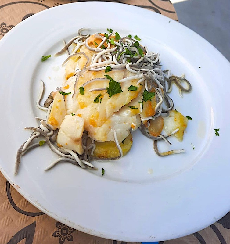 Bacalo con gulas is one of the most famous Spanish seafood dishes